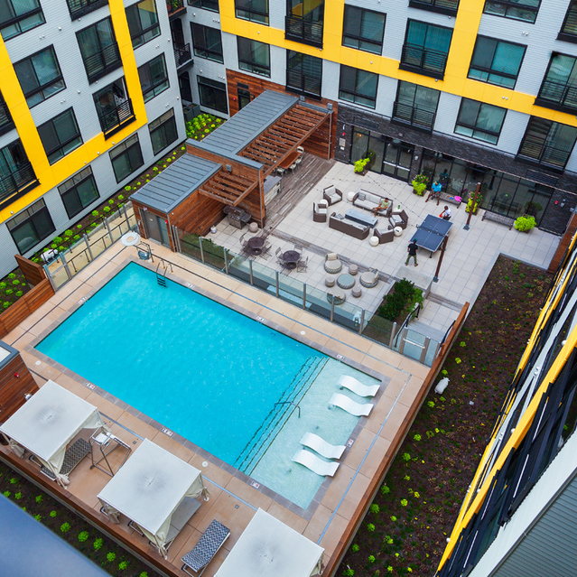 Fenwick Apartments - Aerial View of Pool With Wading Lounge, Sunbathing Deck And Cabanas